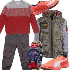 L'arancio è un colore vivace, bello da indossare, soprattutto per le carnagioni più olivastre. Maglione a righe larghe, pantalone cargo in grigio, scarpa sportiva, giubbino multicolor e super sportivo, orologio della lego di Star Wars.