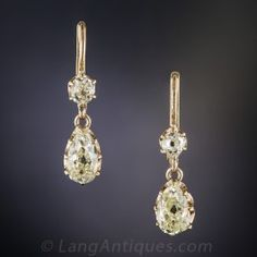 Understated elegance meets extravagant sparkle in these lovely, extremely wearable diamond ear drops, dating from the first or second decade of the last century, composed of a pair of antique pear-shape diamonds ( 1.40 carats total) dangling from a pair of small old mine-cut diamonds (.30 carats), for a grand total of 1.70 carats of dancing dazzle. Hand fabricated in 14K yellow gold. 3/4 inch.