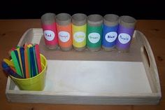 Color matching with toilet paper rolls and colored popsicle sticks.