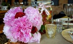Wedding Planning in Switzerland  Bouquet of pretty pink peonies and red roses - wedding flowers, candy & candles