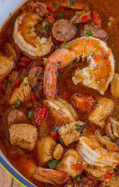 Easy Jambalaya (Chicken, Shrimp and Andouille) - Dinner, then Dessert Easy Jambalaya made with Chicken, Shrimp and Andouille Sausage in under 45 minutes. Served over rice or rice cooked with the jambalaya for one pot meal. Chicken Jambalaya, Slow Cooker Jambalaya, Sausage Jambalaya, Chicken And Shrimp Recipes, Seafood Recipes, Creole Recipes, Donut Recipes, Recipes Dinner, Cajun Recipes