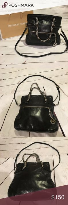 """💕SALE💕 Michael Kors Black Vintage Style Purse Beautiful purse with chain handles & removable long strap. It has 4 pockets inside & 1 zipper pocket inside. It has zipper pocket on the front also. This item has been used & is still in great condition. It has a slight discoloration on the back side that is shown in picture 6, but is really not noticeable unless you are looking for it. It can be worn as a cross body or as a shoulder bag. The measurements are 14"""" height, 14"""" width, 4.5"""" depth…"""