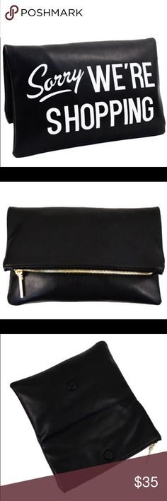 """Black """"We're Shopping"""" Print Decor Clutch ::Features::: T-op Clutch Zipper Open/Closure -Textured Faux (Imitation) Leather -Inside lining with open/zip pockets -11 (W) x 1 (D) x 7(H) inches -Black with White lettering Bags Clutches & Wristlets"""