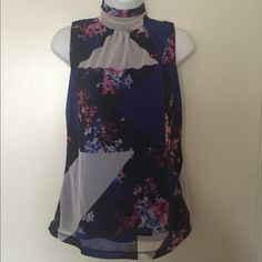 Worthington top blue - flowers hign neck medium Worthington turtle neck. Sleeveless. Blue with dark n light pink flowers, white and black also. Light fabric, lined in solid blue. Size PM Worthington Tops Tank Tops