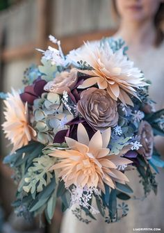 DIY Rustic Paper Bridal Bouquet made with Cricut Explore -- Lia Griffith. Round 3 Make this paper rustic bridal bouquet with a glue gun, paper and a cricut explorer. Step by step instructions to make your own rustic paper bouquet. Paper Flower Tutorial, Paper Flowers Diy, Fake Flowers, Handmade Flowers, Flower Diy, Flower Making, Paper Flower Patterns, Paper Flower Centerpieces, Paper Flower Art