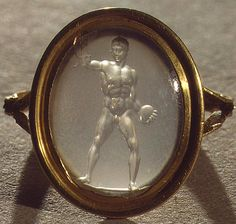 Roman Chalcedony Discus-Thrower Intaglio Ring, 1st Century BC/ADManufactured in the workshop of the master carver Solon, set in a modern gold ring. The ancient Greek gem carver Solon (active 70–20 BC) worked in Roman imperial circles, fashioning idealized portraits of the emperor Augustus and his sister, along with images of mythological figures. Solon's signature is preserved on five ancient gems. His carvings gained great popularity in the 18th century due to the outstanding quality ...