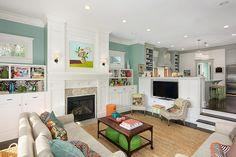 Love the use of color accent in this transitional design. It makes the room feel so happy.