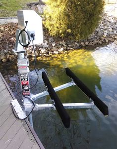 American Muscle Docks & Fabrication has re-designed the classic Mr. Lifter™ Jet Ski Lift to allow the lift to be used with the larger/heavier PWC on the water today Boat Hoist, Pontoon Boat, Seadoo Jetski, Jet Ski Lift, Floating Boat Docks, Lake Dock, Boat Design, Water Crafts, Fishing Boats