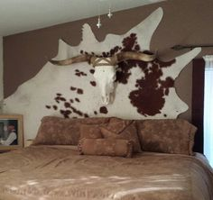 Western headboard ideas... Love the hair on cow hide as a headboard!!