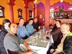 Some of the development team enjoying their usual Friday curry lunch.