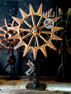 Ornate 1800's cast iron wheel mounted on an antique jack pedestal. One-of-a-kind. Part of the HLJ Sculpture Series
