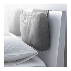 SKOGN Cushion IKEA Adds comfort to your headboard. Great if you sit up and read or watch TV.   metal bar, in the part that hangs over the headboard,  keeps it in place