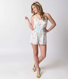 The loveliest thing in the lagoon! An airy chiffon summer romper in a retro reminiscent flamingo print, complete in bright hues of coral pink and aqua blue set against white. A sleeveless bodice boasts a subtle v-neckline, nipped at the natural waist with