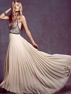 Belle of the Ball Maxi | Pleated chiffon maxi dress with a sequin and embroidered bodice. Plunge V neckline with leather braided trim and straps and a scalloped outline. Hidden back zip. Lined.