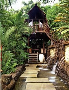 Exotic open living space- gorgeous landscaping and water feature