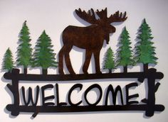 http://www.bonanza.com/listings/Moose-Welcome-signCabin-Lodge-Northwoods-Metal-Art-Hand-Painted-Gift-Pine-Trees/65589221