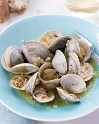 Clams the Sailor's Way --It's not uncommon in Galicia to have a meal that consists of lots of shellfish, bread and nothing else. Encarna Méndez of Do Ferreiro winery prepares clams the fisherman's way: steamed in Albariño with onion and garlic.