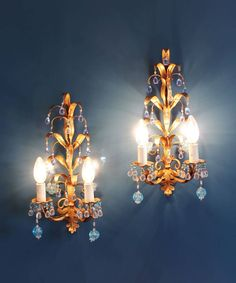 Stunning pair of Murano glass and gilt sconces. Italian wall lamps, midcentury vintage 50s. by elNidosingular on Etsy https://www.etsy.com/listing/506615706/stunning-pair-of-murano-glass-and-gilt