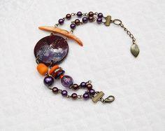 """Bracelet double """"Bollywood""""- Lentille FIMO violette, nacre orange sur métal bronze.-Collection """"Voyages"""" : Bracelet par perles-et-petales"""