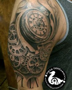 Black and gray clock and gears tattoo