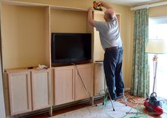 Tips for building bookcases using kitchen cabinets for the base via Worthing Court blog