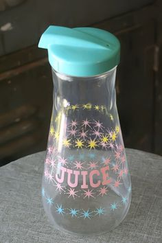 Pastel Pyrex Juice Carafe - I have one of these somewhere in my cabinets. It came with the house.