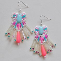 Emma Cassi  Crochet lace embroidered with seed beads, pink thread, vintage sequins and Indian drop beads and Hmong vintage neon beads.  £156.00