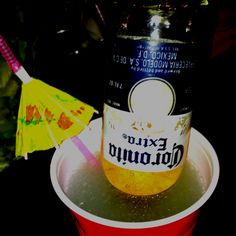 Damon's Beerita:  One part Triple Sec, one part Tequila, some lime juice and an upside down tiny Corona.  Don't forget the umbrella straw!  Party in your red solo cup. ;)