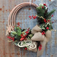 "Minus the ""Merry Christmas"" and add deer antlers. Western lariat rope Christmas wreath rustic cowboy lasso wreath with Christmas greenery, holly, berries, and a glitzy gold Merry Christmas Sign by GypsyFarmGirl Western Christmas Decorations, Western Christmas Tree, Merry Christmas Sign, Cowboy Christmas, Christmas Greenery, Country Christmas, Xmas Decorations, Christmas Time, Christmas Ornaments"