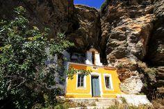 Pretty yellow church nested in the rocks. Ioulida, Kea island, Cyclades, Greece