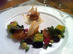 Making a starter, mussle mousse, scallops, pea pure, citrus mousse and alot more