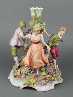 "Lot 33, A 19th Century Continental porcelain candelabrum base with 4 figures dancing around a tree the base encrusted with flowers 12"" est £40-60"