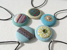Transfers on polymer clay.  Fabi, the artist, lives in Madrid