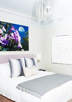 The Best It-Girl Bedrooms// flower art, purple headboard, snakeskin print