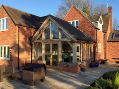 Shires Oak Buildings, based in the heart of England, are specialists in the design and build of oak framed structures, including garden rooms and garages. Front Elevation, House Projects, French Doors, Extensions, Brick, Porch, Buildings, Scrapbook, Cabin