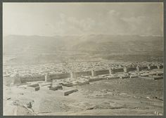 """China, Kan-su (Tangar). View of the city. [Title from recto of photo mount.] From Vol. 4, dated Sept. 20, 1925: """"Tangar is the last town in China. Today I climbed a hill back of the town on which are situated various temples one dating back to the 7th year of Kien-lung. The newest (Wen-ch'ang Kung) to the 2nd year of Kuang Hsü. We took several photos of the town with its flat roofs and the long row of temples situated against the north wall of the town....""""  Joseph Rock - On Shadow"""