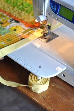 A Little Help When Sewing On Binding | Flickr - Photo Sharing! - wind binding around the leg of the machine to keep it untangled while you stitch
