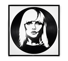 """Framed portrait of Debbie Harry of Blondie, laser-cut on a reclaimed 12"""" vinyl record. It is framed in a premium LP frame made of sturdy aluminum and glass."""