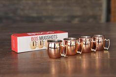 BOS Mugshots, set of four mini (2oz) Moscow Mule Shot Glasses. You can order mini Moscow Mule Shot Glasses for your kitchen. Each item purchased donates.