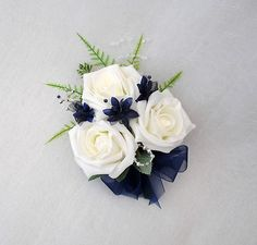 WEDDING FLOWERS - LADIES CORSAGE IN IVORY ROSES WITH NAVY BLUE AND SILVER