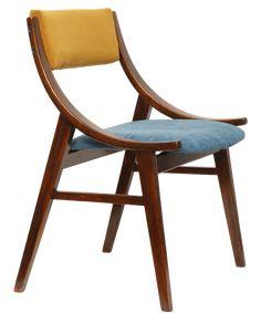 """Krzesło """"Skoczek"""", powstało w Zamojskich Fabrykach Mebli, projektant nieznany, produkowane masowo w latach 60-70. Źródło: http://lata60-te.pl/sklep/krzeslo-skoczek-miodowe-lata-60/"""