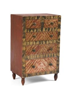 """EARLY PENNSYLVANIA SMOKE DECORATED AND FANCY PAINTED PINE SPICE CHEST. The central long drawer with pencil inscription """"Josephine E. M. Wentz / her hand writing and / spelling"""