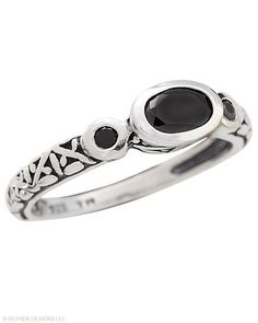 This Ring is the jewelry equivalent of the very versatile little black dress. Black Cubic Zirconia, Sterling Silver.