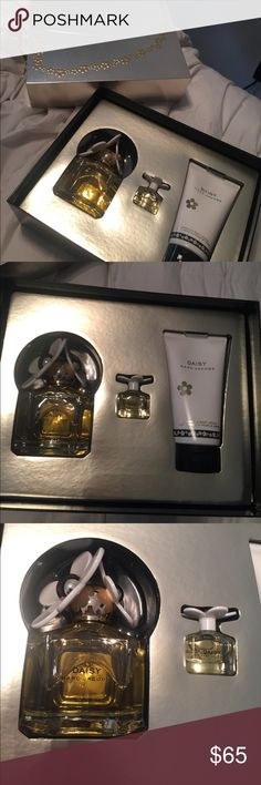 Marc jacobs Daisy set Never been used. Received as a gift. Comes with perfume. A travel size and a luminous body lotion Marc Jacobs Makeup