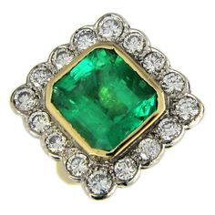 Large Emerald Diamond Gold Cluster Ring | From a unique collection of vintage cluster rings at https://www.1stdibs.com/jewelry/rings/cluster-rings/