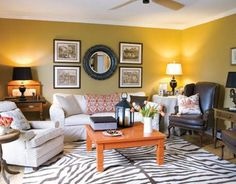 Red living room with white sofas and zebra rug...I don\'t think I ...