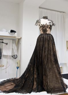 Valentino. This dress is magic. I want it. I want to wear it and be important enough to be seen in it.