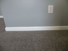 Gray walls, gray carpet with white trim