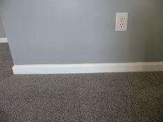 Gray walls, gray carpet with white trim