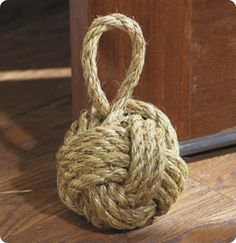 "DIY  rope knot doorstop for $15  materials needed: tennis ball, 1500 BBs (to add weight), 10ft. of 3/8"" diameter manila, exacto knife, drill, hot glue"